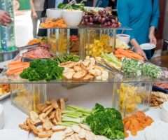Fruit, vegetable, cheese and meat spread at a life celebration